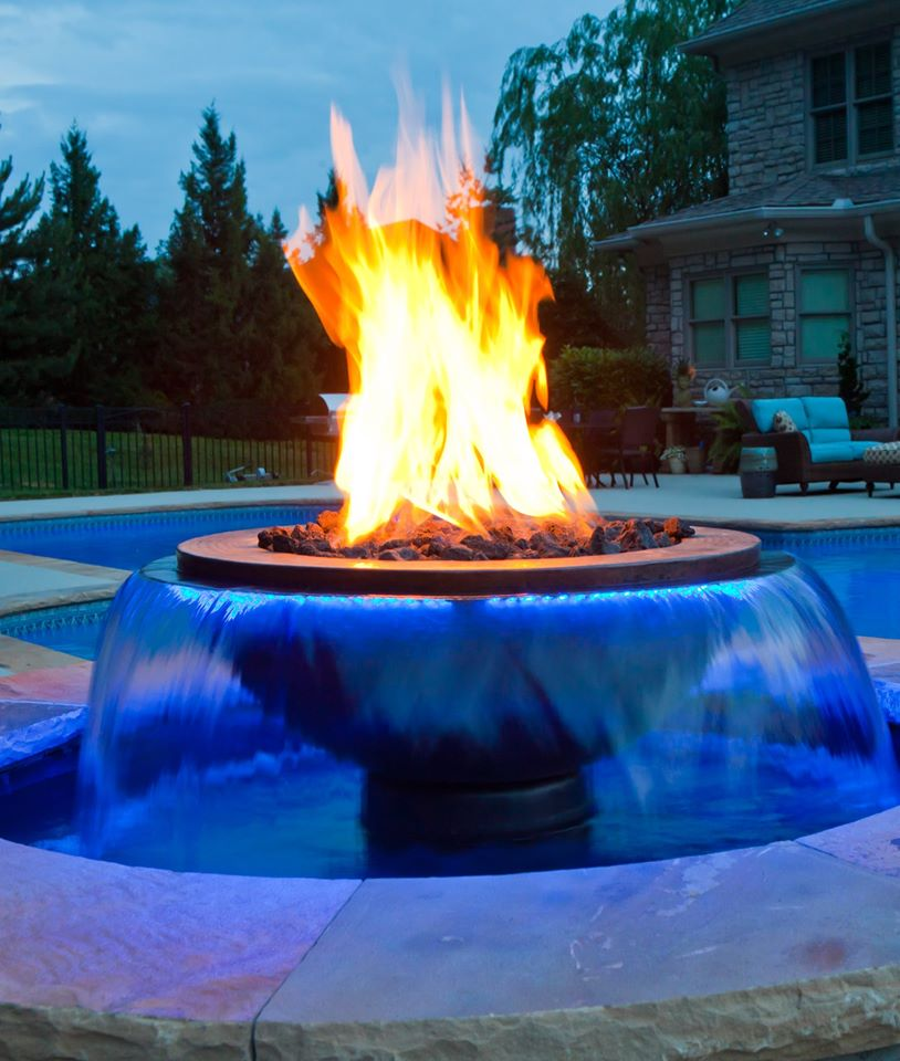 Evolution 360 fire and water feature by a pool